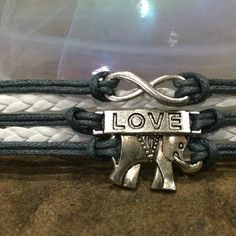Some Elephant Love 2 Infinity Leather by PureEssenceJewelry