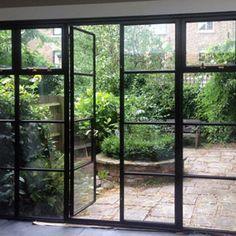 crittall doors and courtyard garden Crittal Doors, Crittall Windows, Steel Doors And Windows, Barn Windows, Steel Frame Doors, Casa Patio, Garden Doors, Kitchen Doors, Kitchen Extension Doors