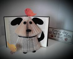 Hey, I found this really awesome Etsy listing at https://www.etsy.com/listing/525717252/book-sculpture-book-art-dog-theme-gift