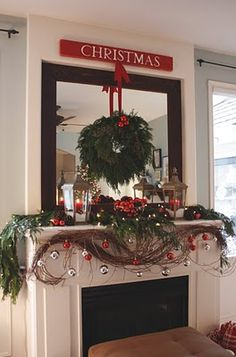 A really classy Christmas mantle - just one of many great mantles at It's the Little Things that Make a House a Home Blog.