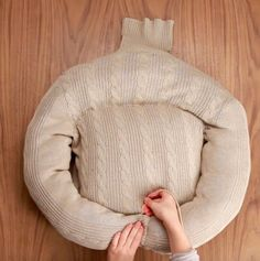 And finally, stitch the arms to the body of the bed to keep them in place.   Upcycle A Thrift-Store Sweater For Your Pet