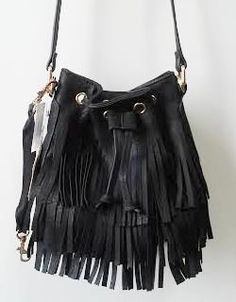 bf25eeae85 Beautiful and unique fringe handbags available exclusively at Monica s  Closet
