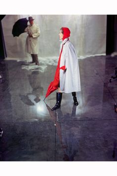 1949-a-woman-models-a-striped-raincoat-with-a-red-hood-and-umbrella-a-man-wearing-a-trenchcoat-stands-behind-her-with-an-umbrella-image-by-genevieve-naylor