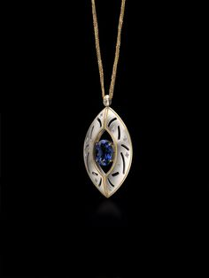Zoltan David  Oval Tanzanite set in Palladium with Pure Gold Inlay and Ideal Cut Diamonds Necklace