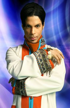 Prince Born in 1958. He even looks at us all with a smirk that tells me he knows women think he's sexy. As I look at the picture... he feels sexy. I would too the way women act around him, wouldn't you.