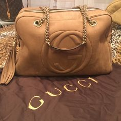 Gucci soho handbag Gucci soho medium sized handbag with chain. Nubuck nude. Authentic. ENC- excellent like new condition. Used very lightly. Comes with original dustbag. Holds lots of stuff. Zipper inside along with 2 small pockets for organization. I am obsessed with this bag! Don't want to let it go but will sell to buy a different Gucci. Gucci Bags Shoulder Bags