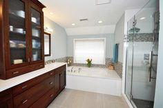 Master bath, Elmwood Fine Custom Cabinets, cherry, Caesarstone Misty Carrara countertops.  Glass and marble accent tiles.
