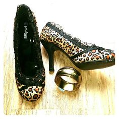 Leopard Print Ruffle Heels by Pulse Size 8 These shoes are hot! Super cute animal print with pleated black ruffles around the foot. Black ribbon bows finish the look. Perfect for a night out on the town. They will set off any little black dress!  Get wild without wildly spending.  Heel measures just shy of 4 inches.  Very little wear. Pulse Shoes Heels