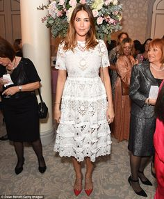 Pretty lady: The radio DJ looked chic in an embroidered white tea dress as she posed for photos at the Future Dreams Autumn Lunch, which was helping to raise funds and awareness for Breast Cancer Research