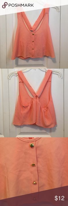 Coral Crop Top Never worn! This is included in a bundle as another listing and it includes a skirt and shoes. The color on this is coral. Let me know if you have any questions and feel free to make an offer Charlotte Russe Tops Crop Tops