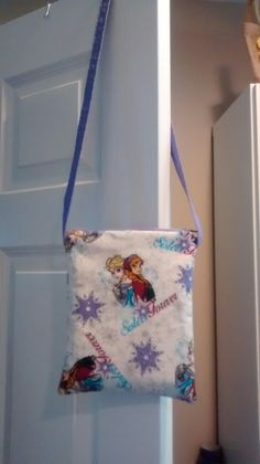 Frozen cross-body bag with lavender lining and straps