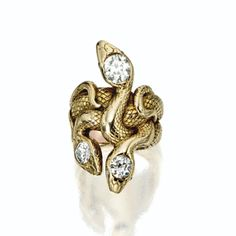 GOLD AND DIAMOND SERPENT RING, LATE 19TH CENTURY. Designed as three entwined serpents, the bodies engraved with scales, the heads set with 3 old-mine diamonds weighing approximately 2.10 carats