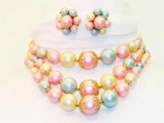Vintage triple strand bib bib necklace and earring set. True vintage costume jewelry from the 1950's - 1960's era made in Japan. Big chunky beads. Feminine colors and design.