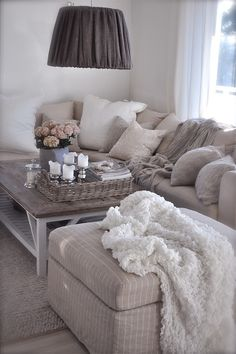Comfy cosy I love greys and lots and lots of cushions...