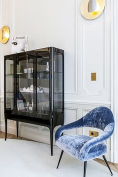 elegant black cabinet with tall legs and glass doors / sfgirlbybay