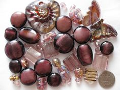 Over 40 pieces assorted golden purple beads and pendants for all your jewelry making and crafting needs :-)