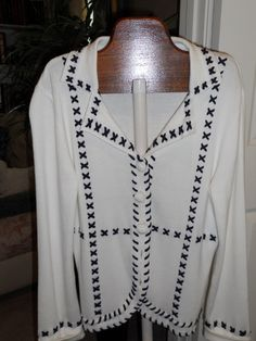 Bob Mackie Studio whip stitched Jacket in LeChic's Garage Sale in Stilwell , KS for $25.00. Bob Mackie Studio White with navy whip stitched tailored jacket with crochet buttons. 60% Cotton, 40% Acrylic SIZE S (but runs a tad generous and would fit most Medium sized ladies).Never worn - has all buttons...