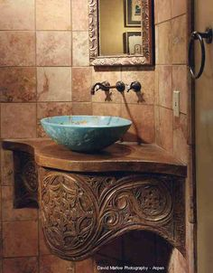 gorgeous sink and beautifully carved wood