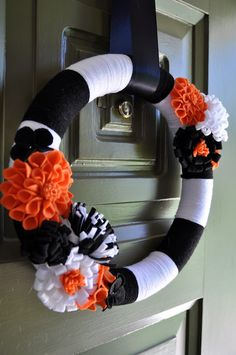 Yarn wreath. Black and white, different color flowers.