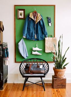 How genius!  Painted peg board with a frame. Add the hooks and your 'picture' can change every day!