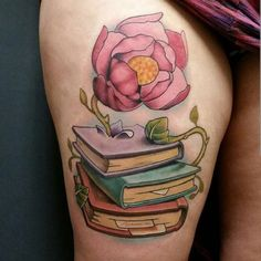 Flower Growing in Book. As mentioned above, books enlighten the world and make everything grow, the same is described in the above book tattoo design in which the book helps the flower to grow.