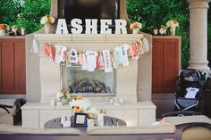 Love incorporating the baby name and love the banner using baby clothes