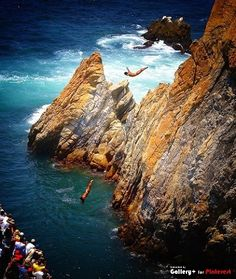 cliff divers, La Qurbrada, Acapulco Mexico. Always get nervous watching the divers dive off these cliffs, especially at night!