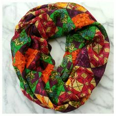 """Geodetic Infinity Scarf by Tolani. Gorgeous bright geometric print infinity scarf in soft, lightweight viscose/silk blend. 30"""" wide x 35"""" long, 70"""" circumference. Dry clean. EUC. Anthropologie Accessories Scarves & Wraps"""