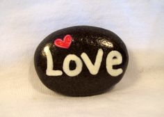 Sticker and hand painted beach stone by Jessica Newton