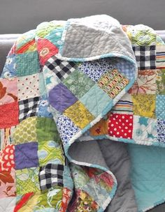Small scrap squares, quilted X through the pieces