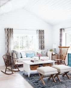 Whitewashed living room with  rustic furnishings {PHOTO: Barry Calhoun}