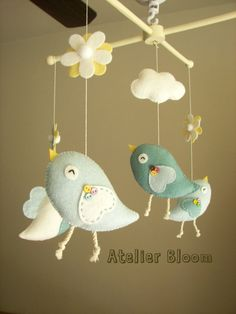 "Baby crib mobile, Bird mobile, girl mobile ""Bird - baby blue"" -- Free Music Box. $80.00, via Etsy."