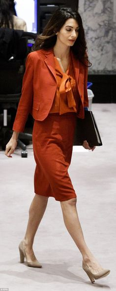 Amal Clooney at UN 3 months after her twins were born. She wore an eye-catching orange suit with a coordinated bow blouse and nude pumps
