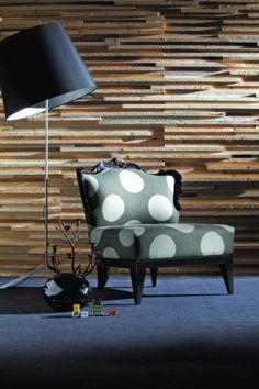 Polka dot chair against a wood facade wall