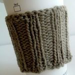 someone beat me to it: knit coffee cup warmer; I'm also thinking about making a quilted one