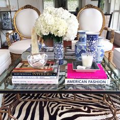 """5. """"Layering"""" A room isn't complete until it's been accessorized and styled.  We find layering gives the most impact. Coffee table books, vases of flowers or orchids, vintage accessories… more is more!"""