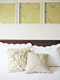 framed scrapbook paper = wall art. So easy and cheap, could do another row and consider it your headboard :)