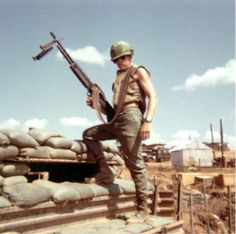 U.S. Marine poses with an M60 -- Vietnam