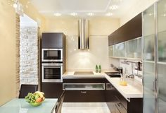 Elegant dark wood cabinets with glass coverings and stainless steel appliances