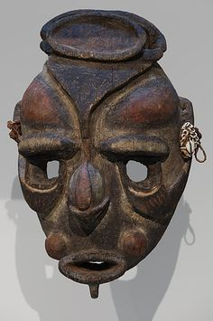 Yuat River region  Mask 19th or early 20th centuries  wood, pigment, fibre, shell ornaments 40.6 h cm