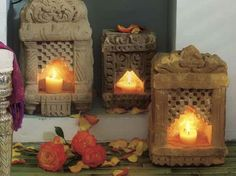 These Vintage Stone Lamps were once part of a wall in India. When a candle or votive is placed inside, it gives off a soft glow perfect for outdoor patios or fireplace hearths. Vintage Stone Lamps are one of a kind and all vary slightly. Tinnin Imports