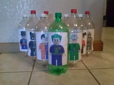 """Bowling Pins for Batman themed party. Attached pics of Lego Batman Villains to 2 liter bottles and """"Knocked out Crime"""" by bowling with a small soccer game ball."""