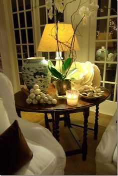Classic barley twist side table, beautiful table top arrangement, windows, ambient lighting