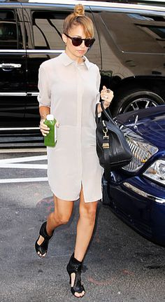 Nicole Richie looked cool and casual in a shirtdress, wayfarers, and a chic topknot in NYC.