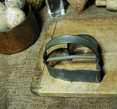 primitive strap-handle heart cutters    I have about 60 antique cookie cutters:-)