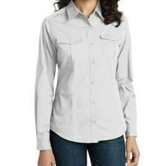 NWOT Port Authority Ladies Stain Resistant Port Authority Stain Resistant Roll Sleeve Twill Shirt 55/45 cotton/poly with soil-release finish 7-button placket to reduce gaping Front princess seams Center back pleat Button-down chest pockets with flap and pleat details Epaulets at shoulder seams Dyed-to-match buttons Roll sleeves with button tabs Adjustable button through sleeve plackets Sleeves Fit 32.5 - 33 inches per website NO TRADES Port Authority Tops Button Down Shirts