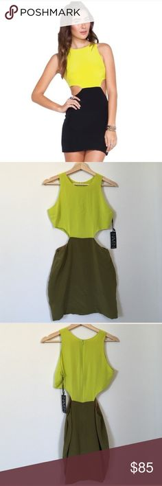 { Naven } cutout dress Naven 2tone Cut out Dress in chartreuse/olive, has zipper in back, side cutouts, new with tags but has been stored so mild storage wear on it in great condition. sold out in stores. (First picture is stock photo to show how it looks on not same colors). Naven Dresses