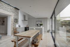 Handpainted kitchen with white Unistone quartz worktops. Design by carolinedunndesign.co.uk. Kitchen manufactured and installed by bespokekitchendesign.co.uk
