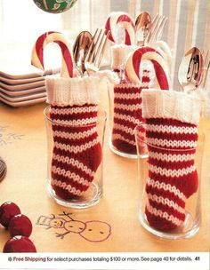 Holiday Tablescapes Trick - Use tiny stockings to hold cutlery (and a candy cane), then simply place in standing drinking glasses !