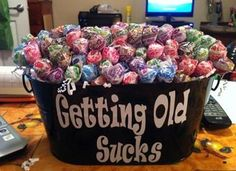 Ok it's cute.  However, let's be real, who would want a plastic bucket full of lollipops for their birthday?  #pinterestisdrunk